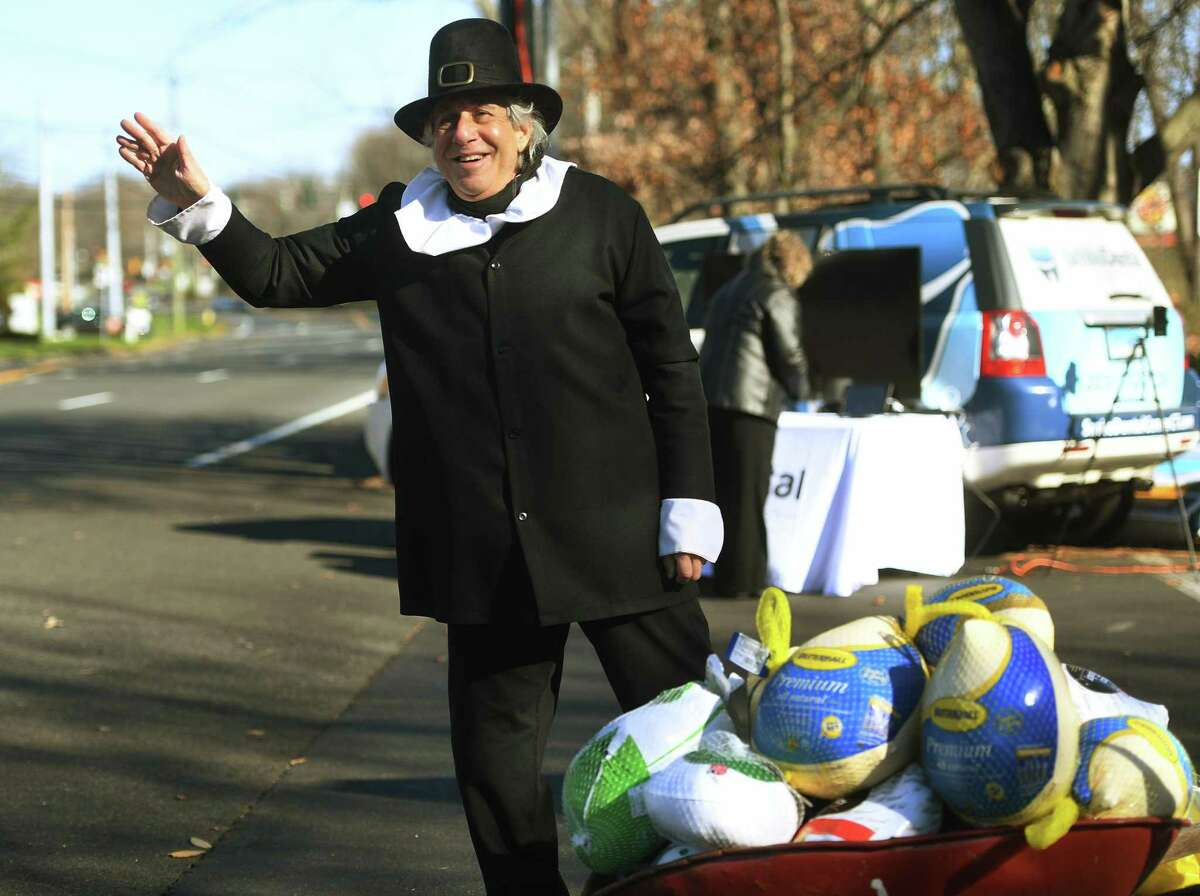 Dressed as a pilgrim, Dr. Bruce Sofferman braves the cold and wind to collect Thanksgiving food donations for the Valley Food Bank outside his dental practice on Bridgeport Avenue in Shelton, Conn. on Wednesday, November 18, 2020.