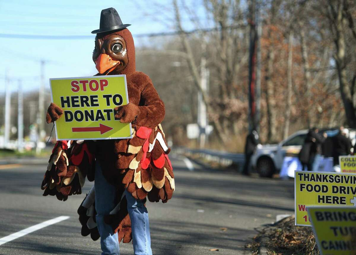 Dressed as a turkey for the occasion, Brendan Carey, of Shelton, works the annual Thanksgiving Food Drive for the Valley Food Bank on Bridgeport Avenue in Shelton, Conn. on Wednesday, November 18, 2020.