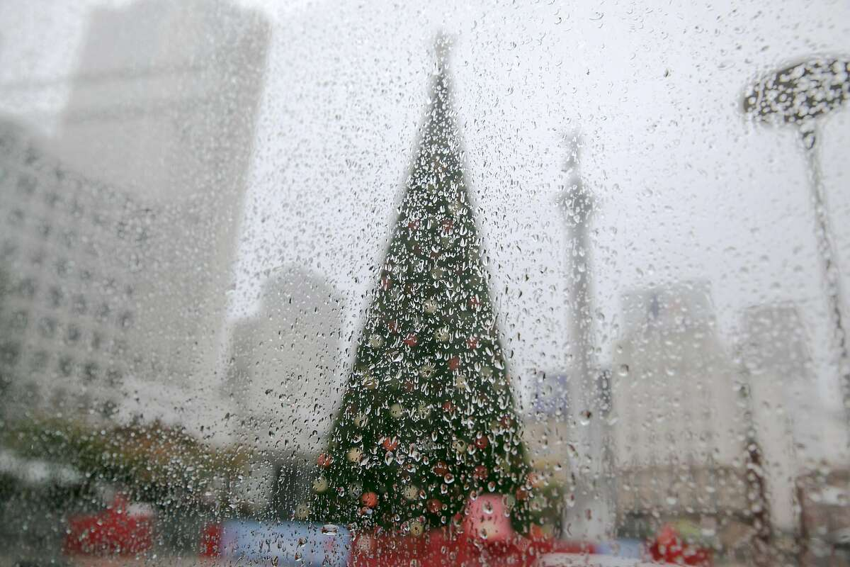 The Macy's Christmas tree in Union Square is seen through a pane of glass covered with raindrops in San Francisco during a steady rainfall. The first significant rainstorm of the season hit the San Francisco Bay Area on Nov. 17, 2020.