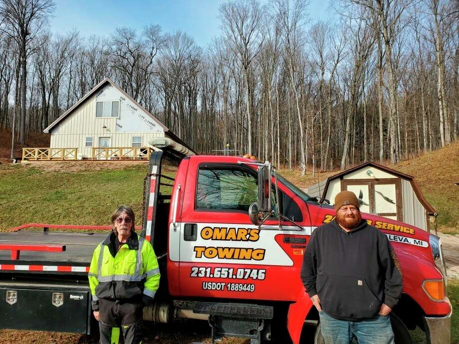 Matt Omar (right) operates Omar's Towing in Manistee County. (Courtesy photo)