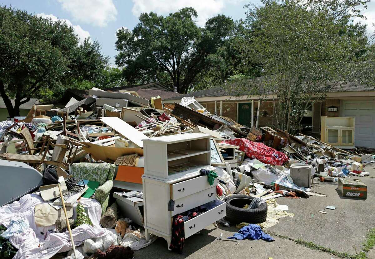 Debris outside a home on Ludington Dr. as residents clean up after Hurricane Harvey flooding in the Westbury neighborhood on Sept. 23, 2017, in Houston.