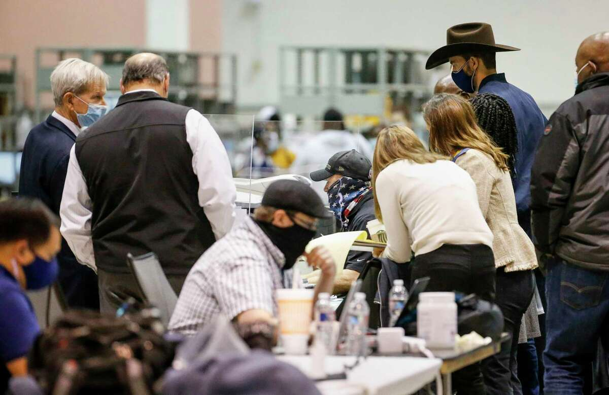 Election workers work before the release of early-voting returns in Harris County on Tuesday, Nov. 3, 2020, at NRG Arena in Houston.