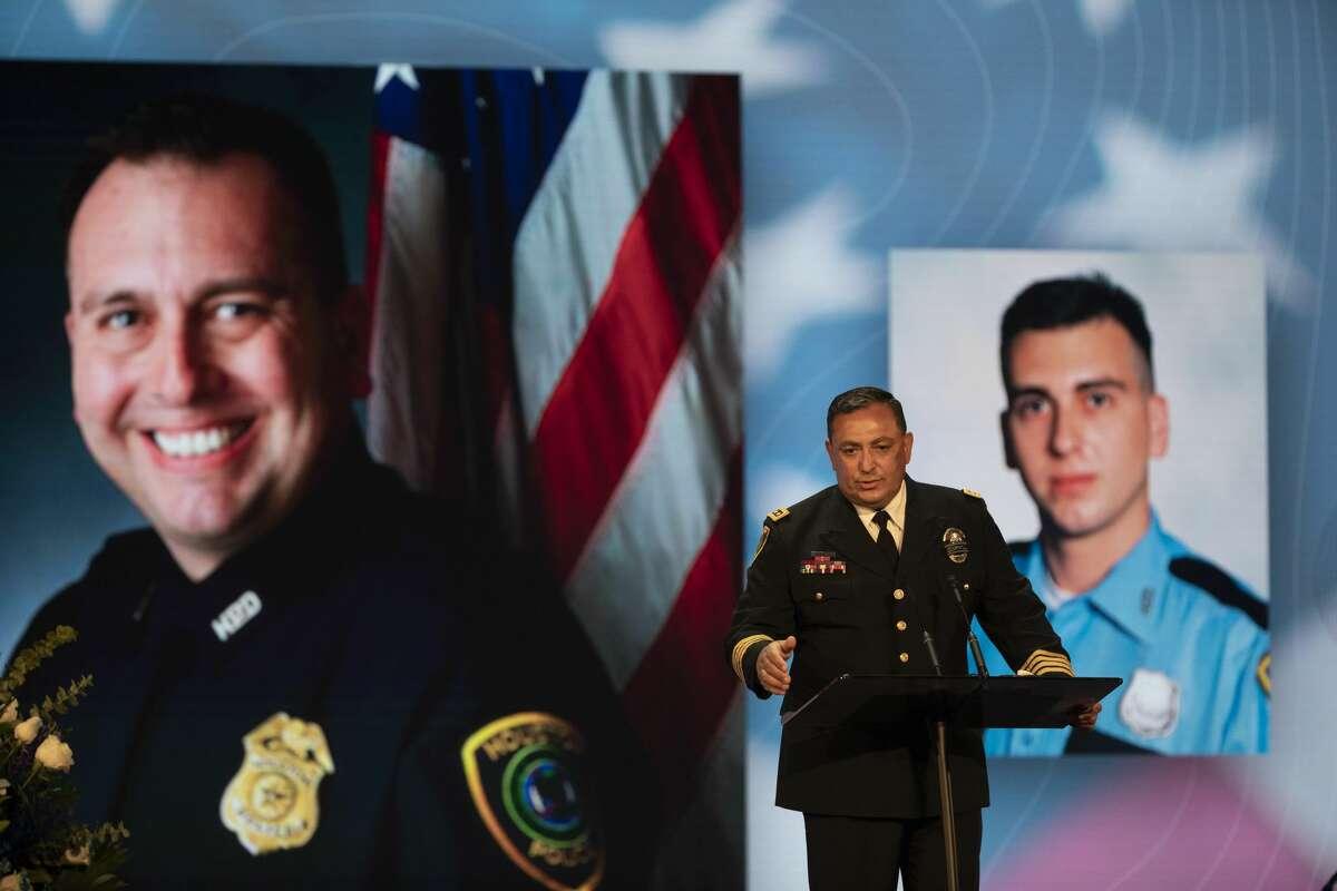 Houston Police Chief Art Acevedo talks to children of fallen HPD Sgt. Sean Rios, who was fatally shot Nov. 9 in a gun battle en route to work, during his memorial service Wednesday, Nov. 18, 2020, at Grace Church Houston in Houston.