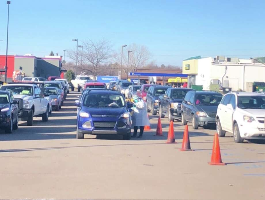 Cars pack the line at the COVID-19 testing site for the Great Lakes Bay Health Center in Bad Axe Wednesday morning. Testing was open until 1 p.m., and will be open again Friday from 10 a.m. to noon, at876 N. Van Dyke Road in Bad Axe. (Michelle Colton/Courtesy Photo)