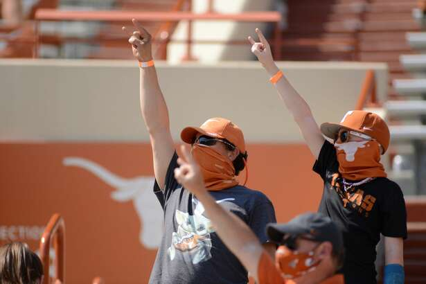 AUSTIN, TX - OCTOBER 03: Texas Longhorn fans cheer during game featuring the TCU Horned Frogs and the Texas Longhorns on October 3, 2020, at Darrell K Royal-Texas Memorial Stadium in Austin, TX. (Photo by John Rivera/Icon Sportswire via Getty Images)