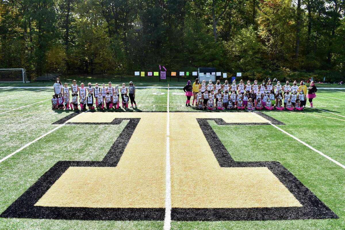 Trumbull Youth Field Hockey's grades 5/6 (left) and grades 7/8 met in a Play for Pink game to raise money to help fight breast cancer.