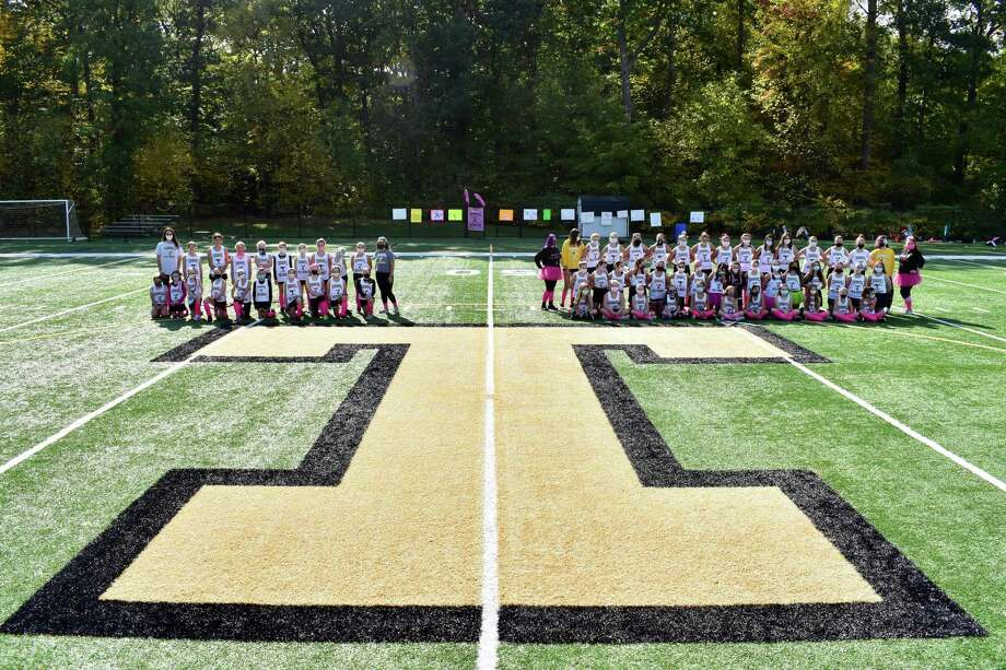 Trumbull Youth Field Hockey's grades 5/6 (left) and grades 7/8 met in a Play for Pink game to raise money to help fight breast cancer. Photo: Trumbull Youth Field Hockey / Contributed Photo / Trumbull Times