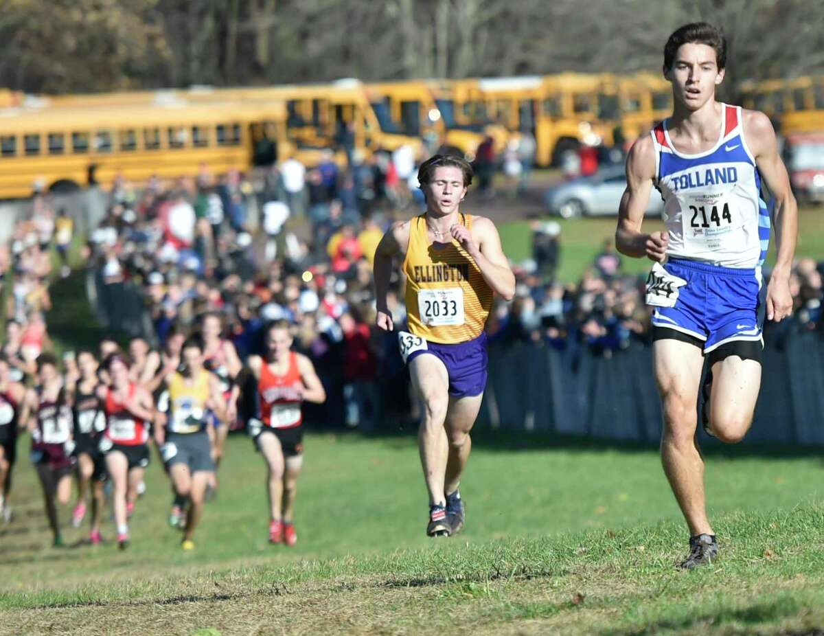 Manchester, Connecticut -Wednesday, November 1, 2019: 7th place finisher Jackson Cayward of Tolland H.S., right, and 8th place fisher Jack Olender of Ellington H.S., second from right, run toward the finish line during the CIAC Boys Cross Country Open Championship Friday at Wickham Park in Manchester.