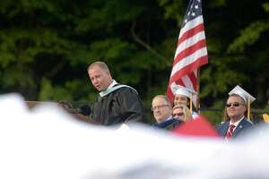 Joseph Kobza, then-principal of Masuk High School, speaks during graduation in 2018. He has been named permanent superintendent for the district.