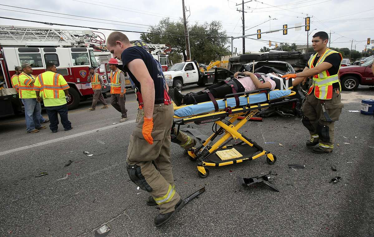 San Antonio EMS paramedics and police work Friday October 9, 2015 at the scene of a four-vehicle major accident where Thousand Oaks, Bulverde Road and Scarsdale intersect. One driver was removed from an SUV with the jaws of life and according to police at the scene two victims were transported by EMS with non-life threatening injuries. The accident took place shortly before 2:00p.m. and involved a pickup truck, an SUV, a Ford Fiesta and a Honda Civic.