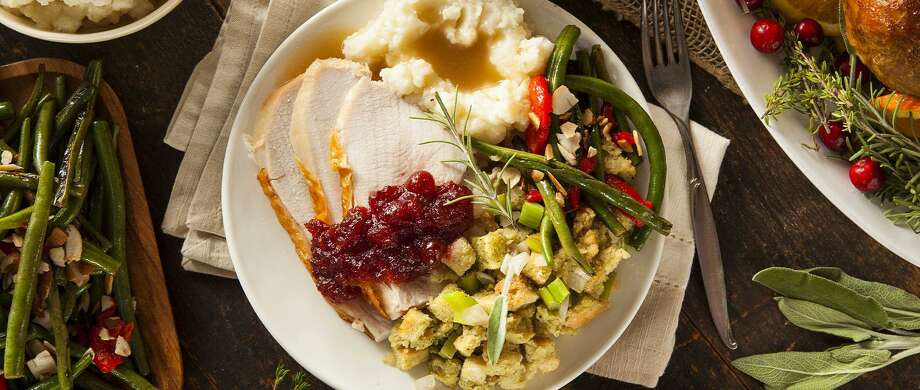 Many Darien caterers, restaurants and markets are offering to feed your Thanksgiving feast this year, including the above family meal from Palmer's Market. Photo: Palmer's Market