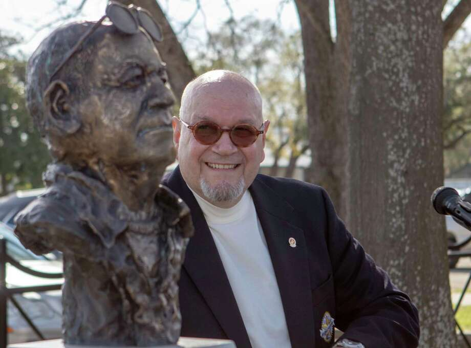 Dave Parsons next to his own bust in Founder's Plaza in downtown Conroe. Parson's poem about late Priest Hubert Kealy is featured in a new Gulf Coast anthology of poetry. Photo: Cody Bahn, Houston Chronicle / Staff Photographer / © 2018 Houston Chronicle