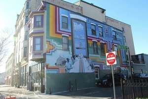 The bottom of the 2010 mural on the St. Vincent de Paul Middletown building on Main Street was created by now internationally-renowned artist Marela Zacarías, children of the former Green Street Arts Center, and soup kitchen clients. The executive director had that part repainted to preserve the structural integrity of the historic building.