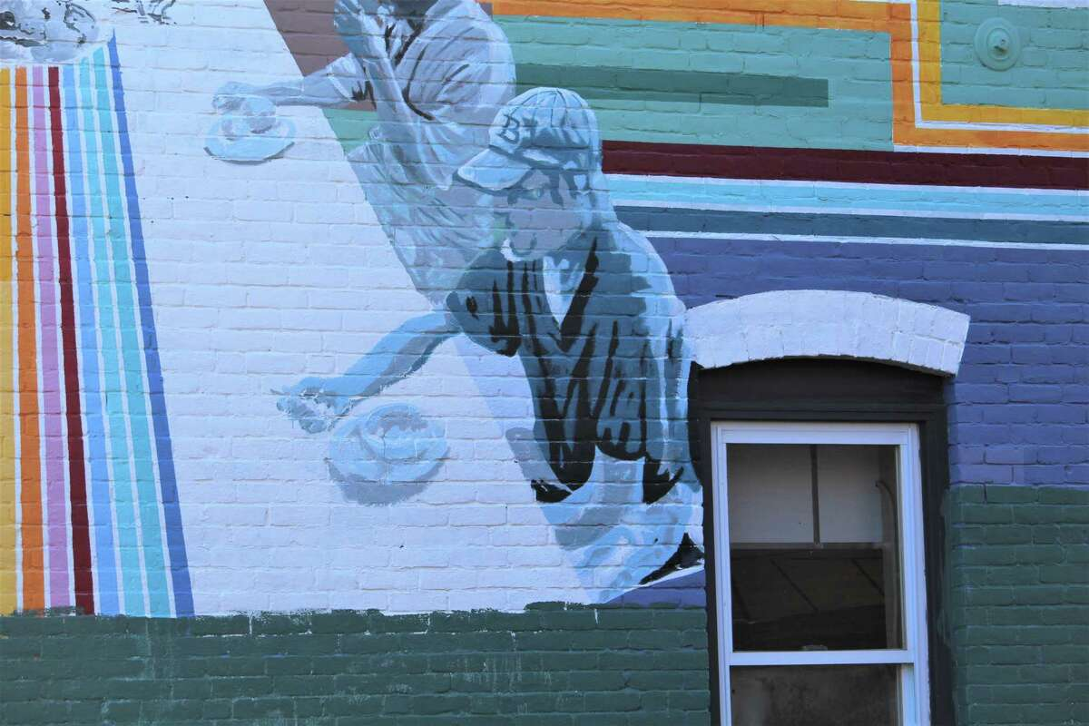 """A portion of the mural on the St. Vincent de Paul Middletown building is a portrait of three soup kitchen patrons. """"It was a beautiful experience to work with them. When there was good weather, we were there until we couldn't work any more,"""" said creator Marela Zacarías."""