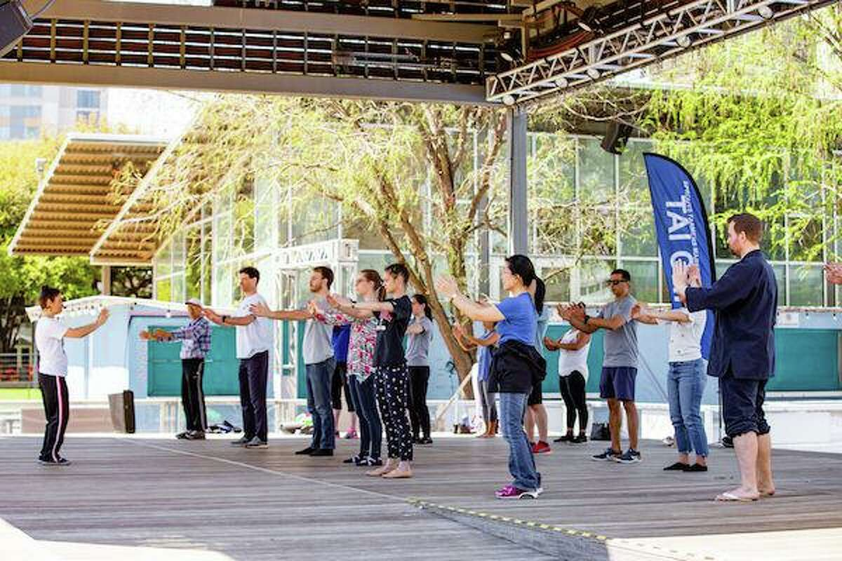 Discovery Green hosts a tai chi class as part of its Fitness in the Park series.
