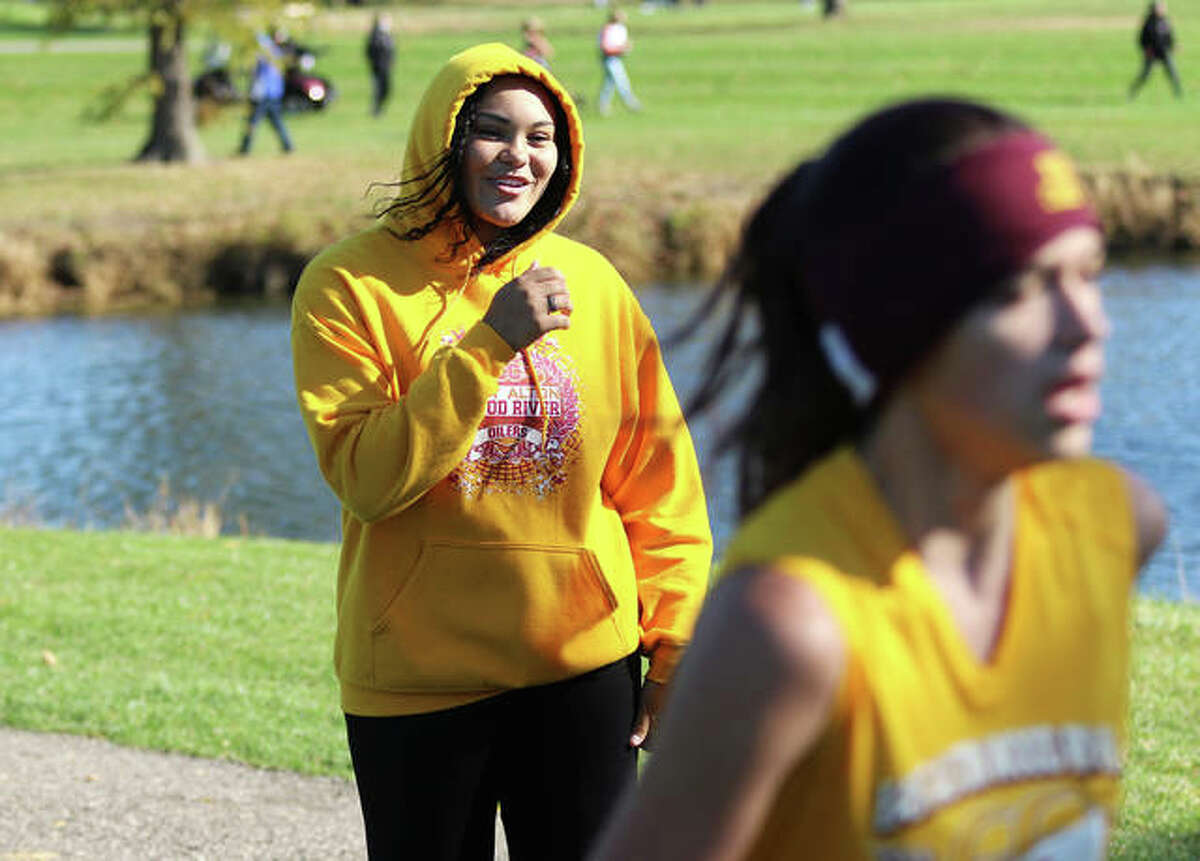 EA-WR' Jayden Ulrich (left) cheers for cross country teammate Megan Douglas, who was the lone Oilers entry at the Decatur St. Teresa Class 1A Sectional on Oct. 31 in Forsyth. Ulrich trained with EA-WR cross country but did not compete in meets.