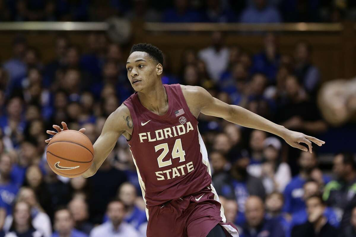 FILE - Florida State guard Devin Vassell (24) dribbles against Duke during the first half of an NCAA college basketball game in Durham, N.C., in this Monday, Feb. 10, 2020, file photo. Vassell is a possible pick in the NBA Draft, Wednesday, Nov. 18, 2020. (AP Photo/Gerry Broome, File)
