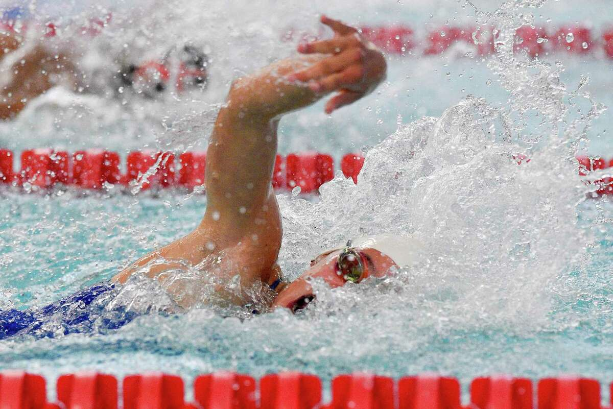 Darien's Natalia Ferranto competes in the 50-yard freestyle against New Canaan in 2019.