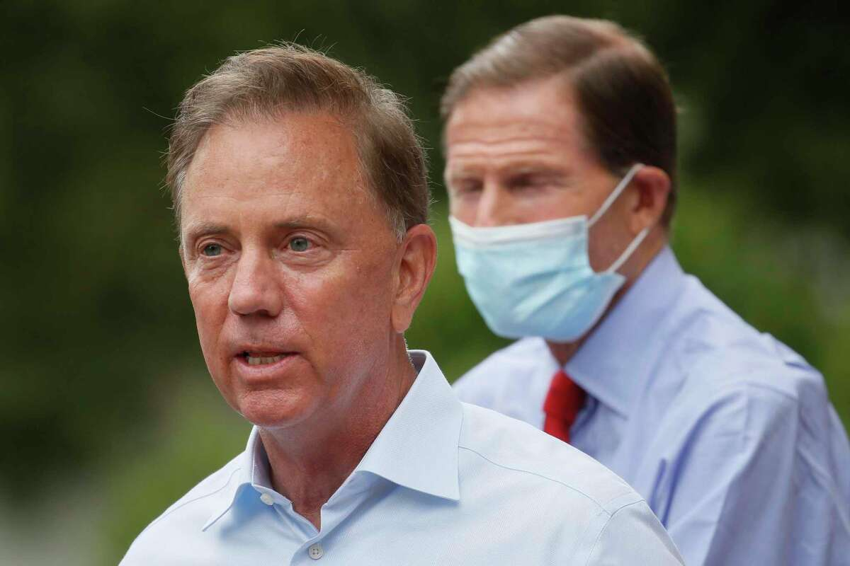 FILE - In this Friday, Aug. 7, 2020 file photo, Connecticut Gov. Ned Lamont speaks to reporters before surveying storm damage in the area in Westport, Conn. As of Nov. 30, 2020, the state was set to pass 5,000 COVID-19 deaths. (AP Photo/John Minchillo, File)