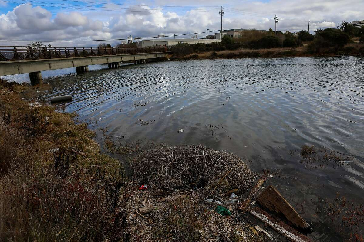 Trash strewn on an embankment at Damon Slough near Oakport Street in Oakland could end up amid the litter washing into San Francisco Bay with the first rains of the season. In September, the California Coastal Commission had to create a new category for PPE in its annual coast cleanup.