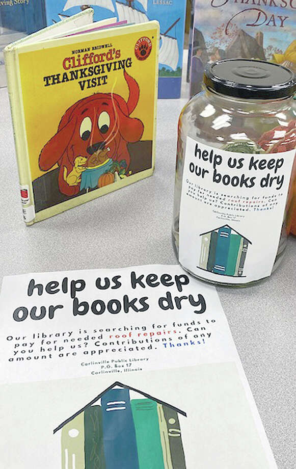 """Help Us Keep Our Books Dry"" is a theme of Carlinville Public Library's funding drive to offset the cost of a new roof. The library's share of the cost of the roof may be as high as $80,000 and could affect the library's budget for years to come. Photo: Photo Provided"
