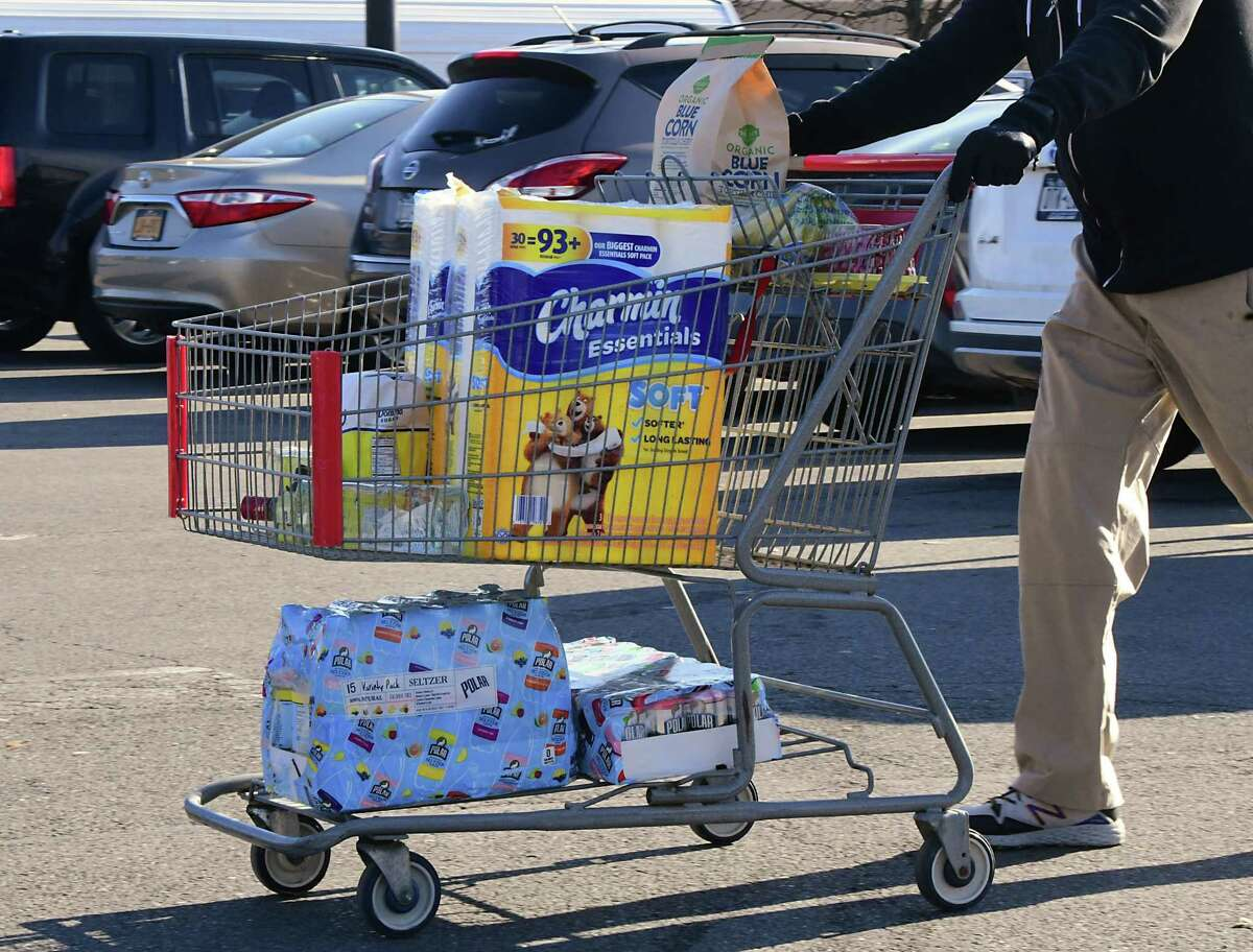 """Almost every cart had toilet paper as customers leave BJ's Wholesale Club on Wednesday, March 18, 2020 in Colonie, N.Y. Retailers on Nov. 18, 2020, said they have planned for a """"second wave"""" of the coronavirus pandemic and there's no need to hoard items like toilet paper and cleaning products. (Lori Van Buren/Times Union)"""