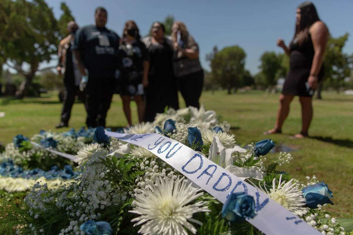 Family and friends mourn Steven Garcias at San Fernando Mission Cemetery in Los Angeles on Aug. 7. Garcias died of COVID-19 at Avenal State Prison.