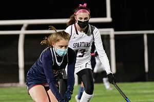Saratoga's Sophie Sefransky, left, is defended by Burnt Hill's Maddy Connelie during the Suburban Council field hockey semifinal on Wednesday, Nov. 18, 2020 in Burnt Hills, N.Y. (Lori Van Buren/Times Union)