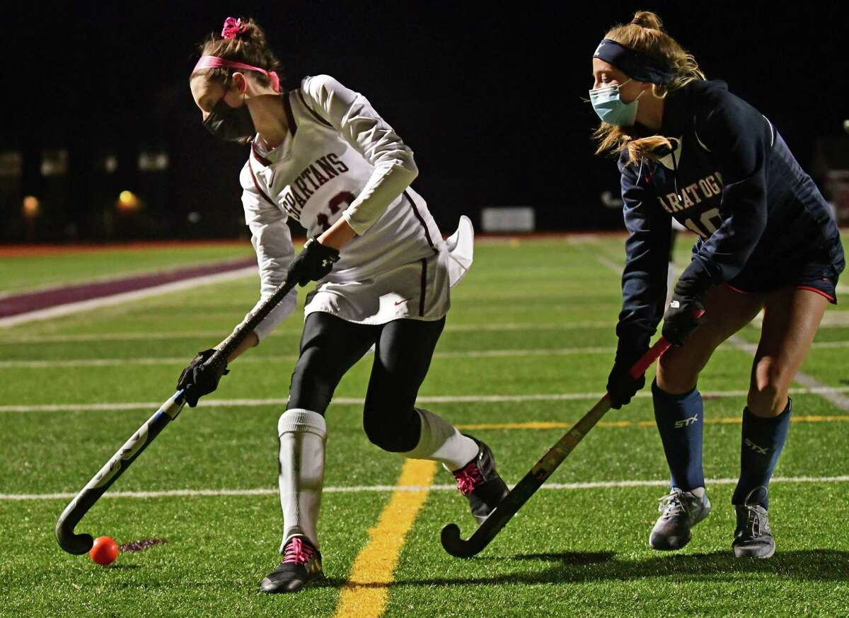 Burnt Hill's Maddy Connelie, left, is defended by Saratoga's Riley Jameson during the Suburban Council girl's field hockey semifinal on Wednesday, Nov. 18, 2020 in Burnt Hills, N.Y. (Lori Van Buren/Times Union)