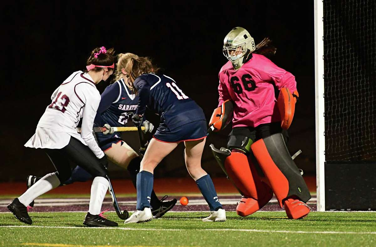 Burnt Hill's Maddy Connelie, left. tries to score against Saratoga goal keeper Emma Piccirillo during the Suburban Council girl's field hockey semifinal on Wednesday, Nov. 18, 2020 in Burnt Hills, N.Y. (Lori Van Buren/Times Union)