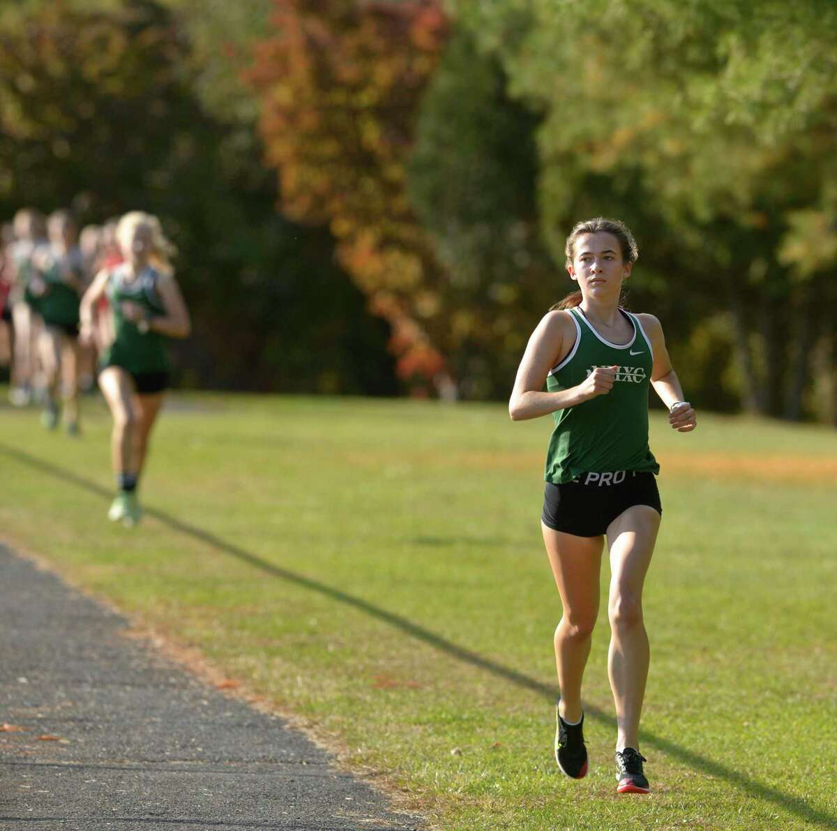 New Milford's Claire Daniels, who finished second, runs in the the girls dual cross country meet between Pomperaug and New Milford high schools Tuesday afternoon. Tuesday, October, 20, 2020, at New Milford High School, New Milford, Conn.