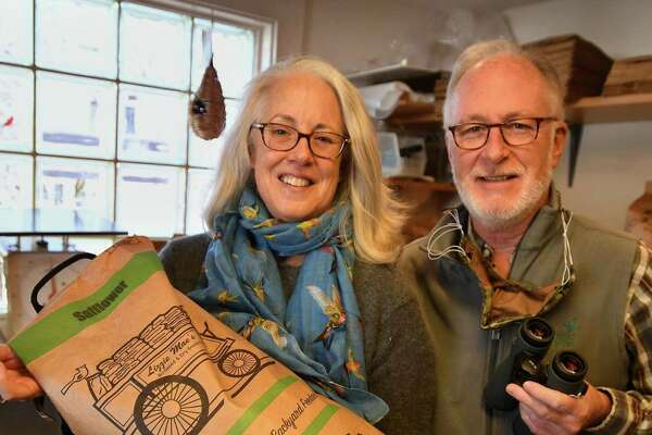 Janet and Jerry Connolly have seen a huge increase in bird seed sales, and all things birding, during the pandemic at their The Audubon Shop store in Madison, Conn. on Nov. 16, 2020.