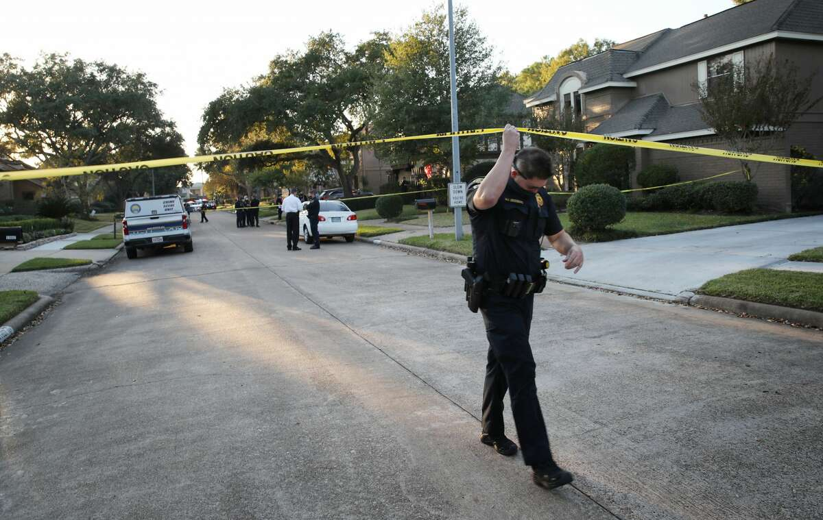Authorities investigate a shooting that left at least one person dead and multiple people wounded Wednesday, Nov. 18, 2020, in the 11600 block of Manor Park Drive in Houston.