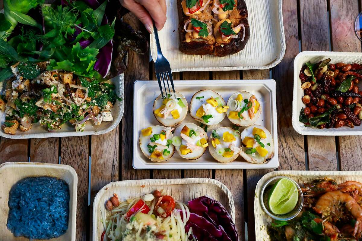 A spread of dishes at Intu-on, an Isaan Thai food pop-up in San Francisco.