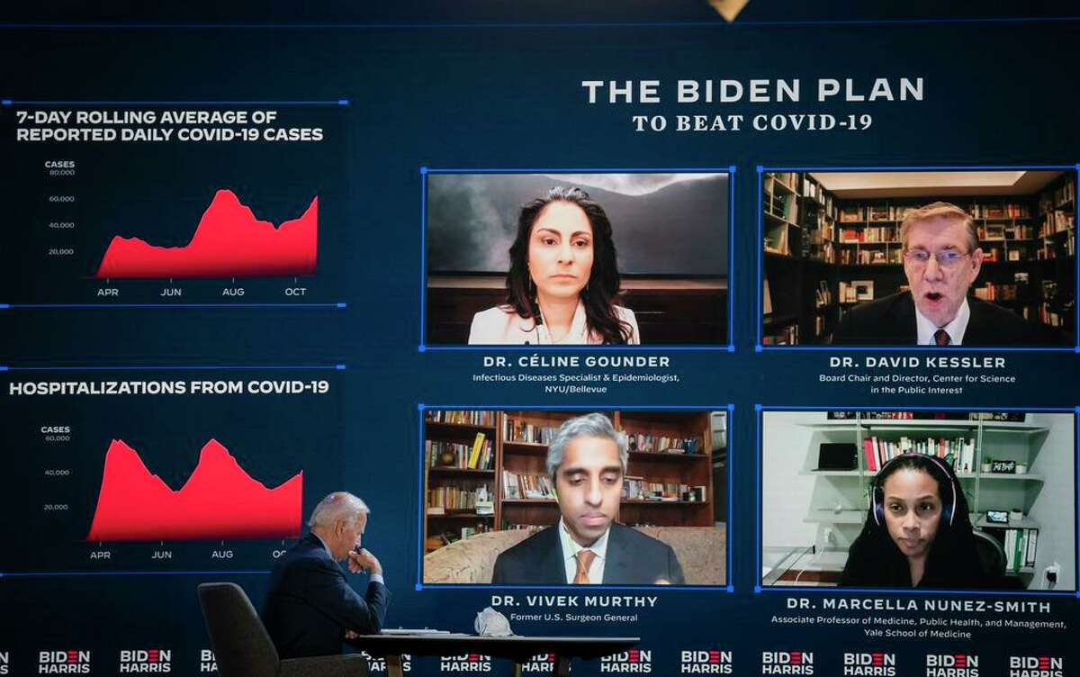 Joe Biden attends an online coronavirus briefing at The Queen theater in Wilmington, Del., on on Oct. 28. Participants include Dr. Vivek Murthy, Dr. David Kessler, Dr. Celine Grounder, and Dr. Marcella Nunez-Smith.