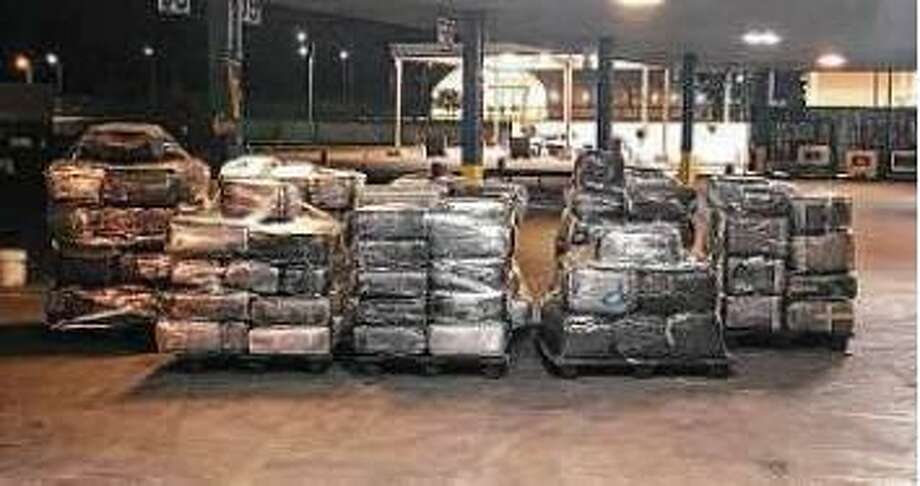 U.S. Customs and Border Protection officers seized more than two tons of marijuana from a man who claimed that he was forced to smuggle the narcotics. He alleged that masked men had his wife held hostage Photo: Courtesy Photo /U.S. Customs And Border Protection