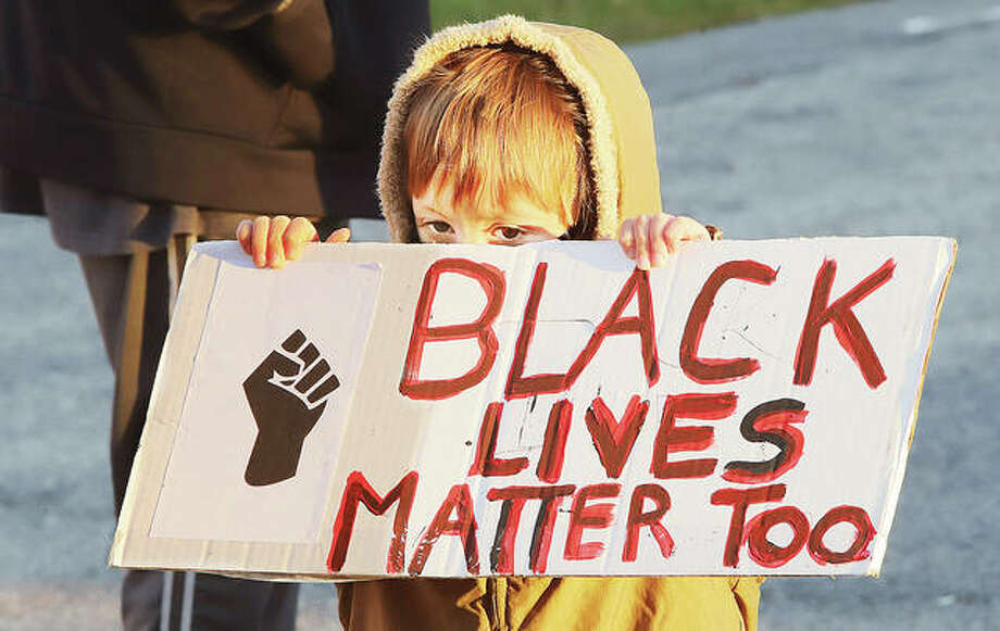 """4-year-old Maveric Homer of Alton holds up a sign Wednesday on a parking lot near the Madison County Courthouse where he was attending a Black Lives Matter protest with his mother. About 40 to 50 BLM protestors turned out ahead of the Madison County Board meeting where they were expected to discuss a resolution supporting police by declaring """"Blue Lives Matter."""" The protestors listened to speeches and sang chants as they stood socially distanced. Photo: Photos By John Badman 