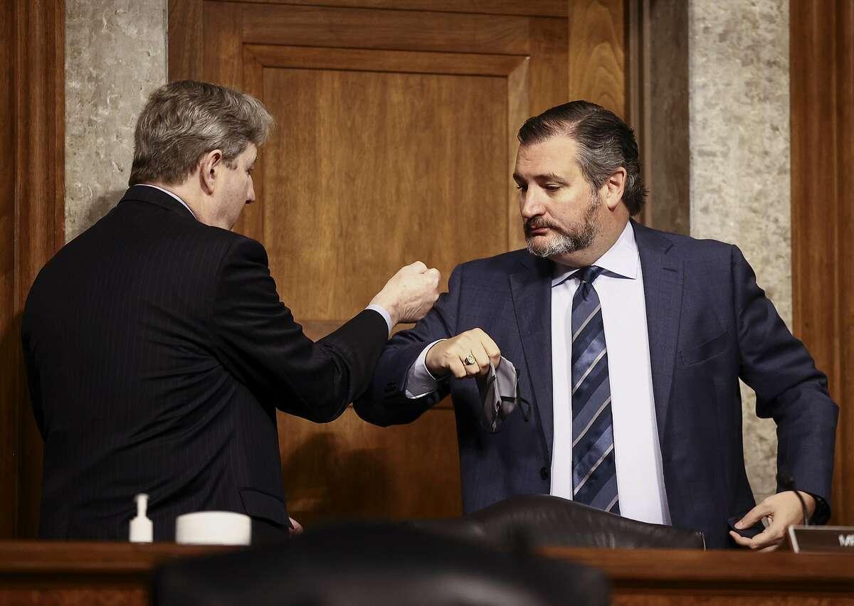 Sen. Ted Cruz, R-Texas, right, greets Sen. John Kennedy, R-La., during the Senate Judiciary Committee hearing on Nov. 17.