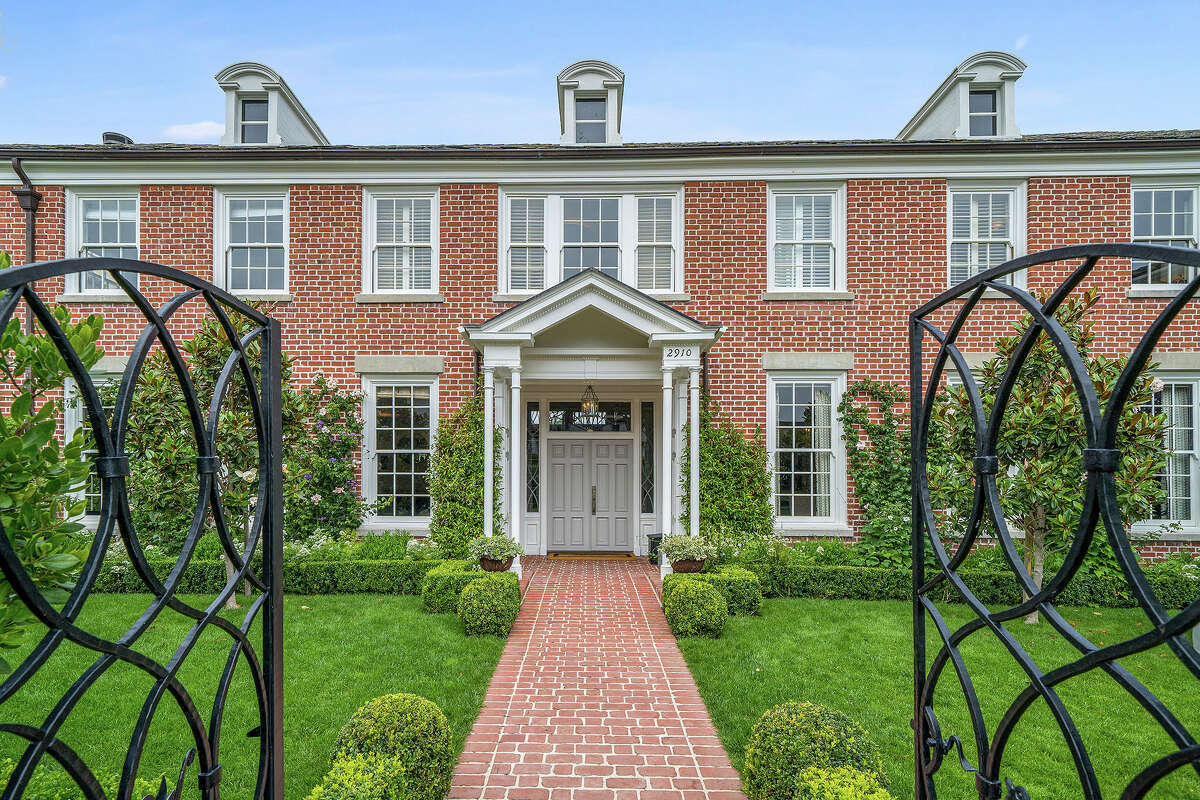 The home spans three levels and has four bedrooms and four bathrooms on a 5,423 square foot lot.