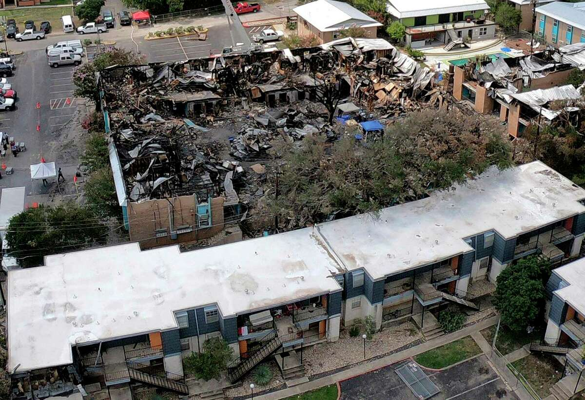 An aerial photograph taken with a drone shows the catastrophic damage caused by a deliberately set fire that killed five people at Iconic Village Apartments in San Marcos on July 20, 2018. No one has been arrested in the case.