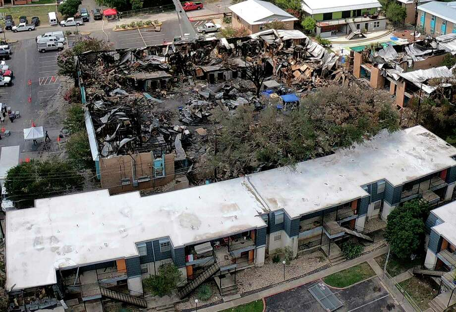 An aerial photograph taken with a drone shows the catastrophic damage caused by a deliberately set fire that killed five people at Iconic Village Apartments in San Marcos on July 20, 2018. No one has been arrested in the case. Photo: Billy Calzada /San Antonio Express-News / San Antonio Express-News
