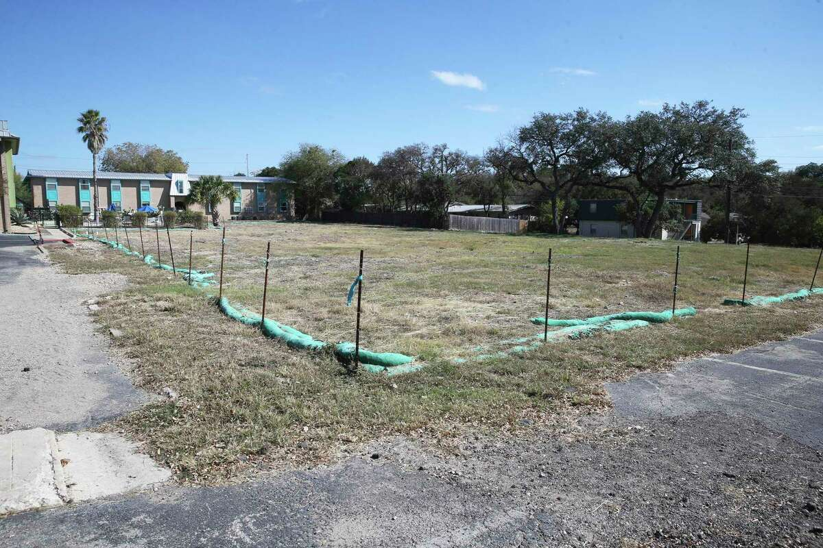 An empty lot seen Wednesday is all that is left at the site of a deliberately set fire at Iconic Village Apartments in San Marcos, where five people died on July 20, 2018.