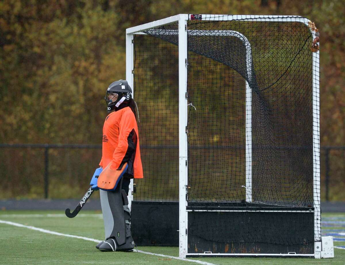 Immaculate goalie Lyla Mellen (00) watches the game from her gaol during the girls SWC Field Hockey South championship game between No. 3 Joel Barlow and No. 1 Immaculate high schools, Friday afternoon, November 13, 2020 at Immaculate High School, Danbury, Conn.