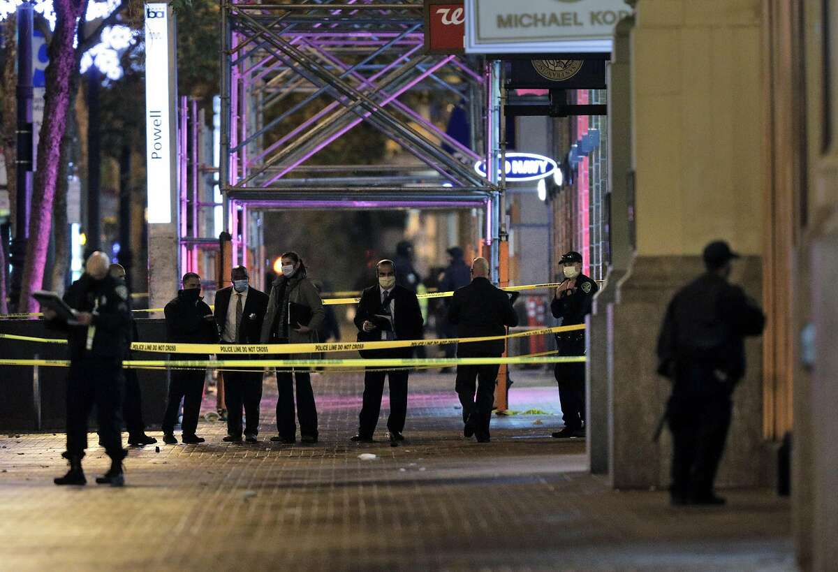 Officers investigate at the scene of a police shooting near the Westfield San Francisco Centre on Nov. 17.