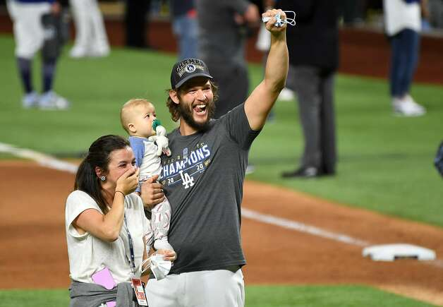 The Los Angeles Dodgers' Clayton Kershaw celebrates with his family after the team's 3-1 series-clinching win against the Tampa Bay Rays in Game 6 of the World Series at Globe Life Field in Arlington, Texas, on Tuesday, Oct. 27, 2020. (Wally Skalij/Los Angeles Times/TNS) Photo: Wally Skalij / TNS
