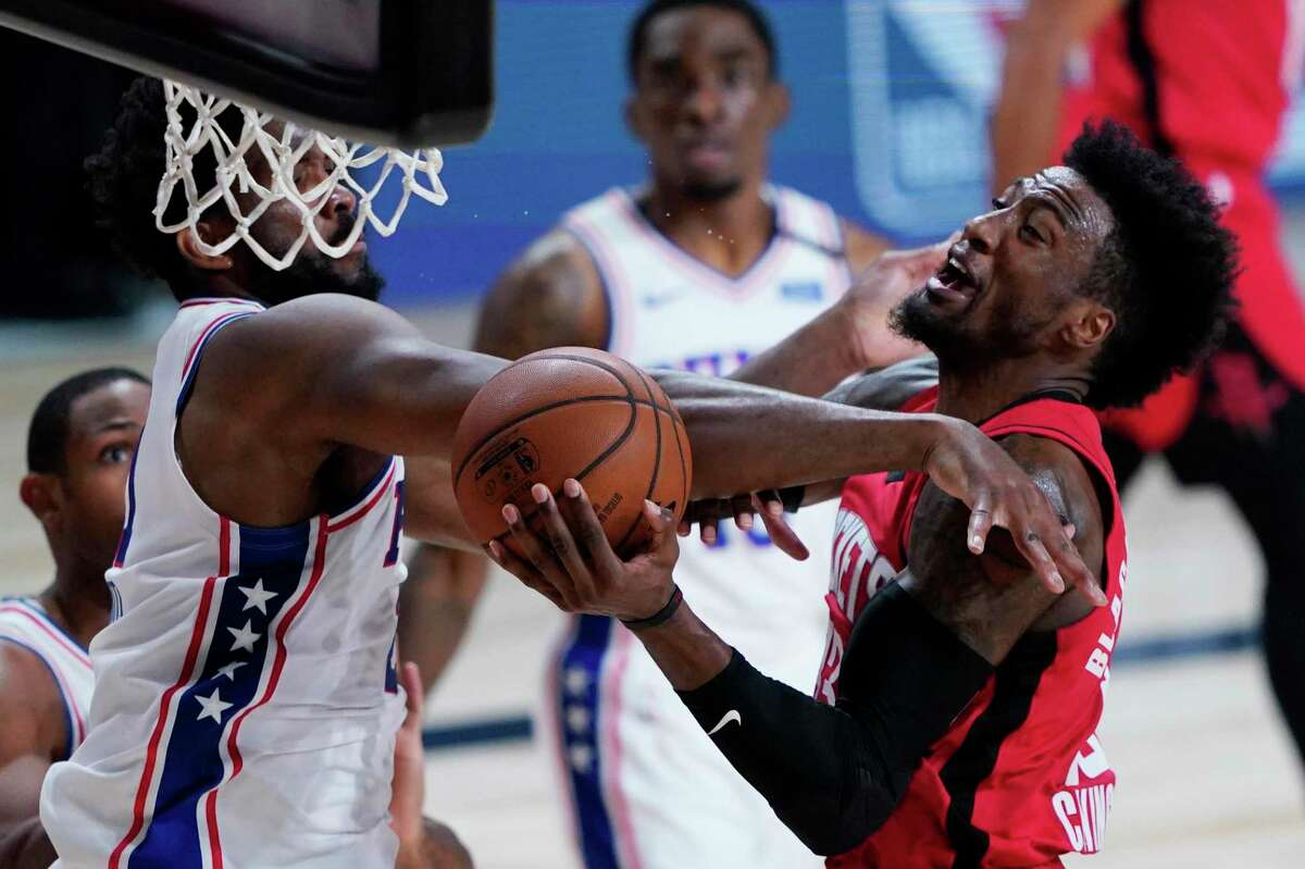 Robert Covington, right, one of the Rockets steadiest players and best defenders last season, was dealt away before the draft.