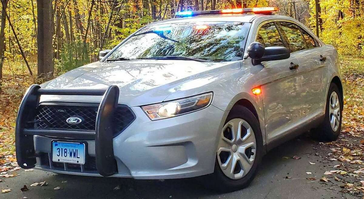 A New Fairfield woman is facing evading responsibility and other charges after state police say she crashed an SUV down an embankment and left the scene.