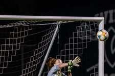 Wilton goalie Erynn Floyd makes a save during last week's FCIAC Central girls soccer semifinal game against Ridgefield.