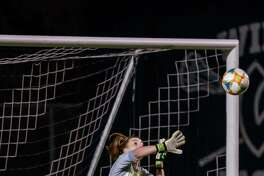 Wilton goalie Erynn Floyd makes a save during last week's FCIAC Central girls soccer semifinal game against Ridgefield.