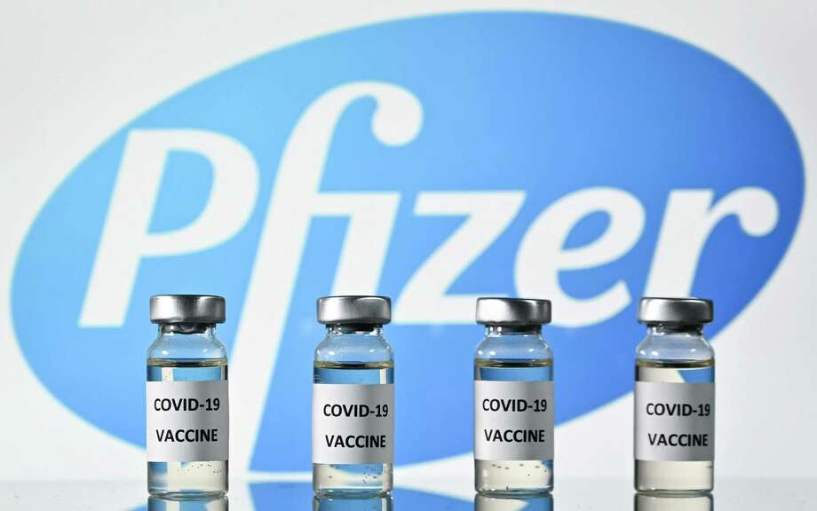 This Nov. 17 illustration shows vials of COVID-19 vaccine, developed by the pharmaceutical company Pfizer, with German partner BioNTech. They will apply within days for federal FDA emergency approval. Photo: JUSTIN TALLIS / AFP Via Getty Images / AFP or licensors